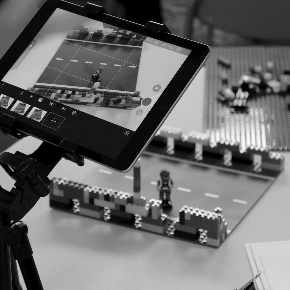 Lego scene being recorded via a tablet on a tripod